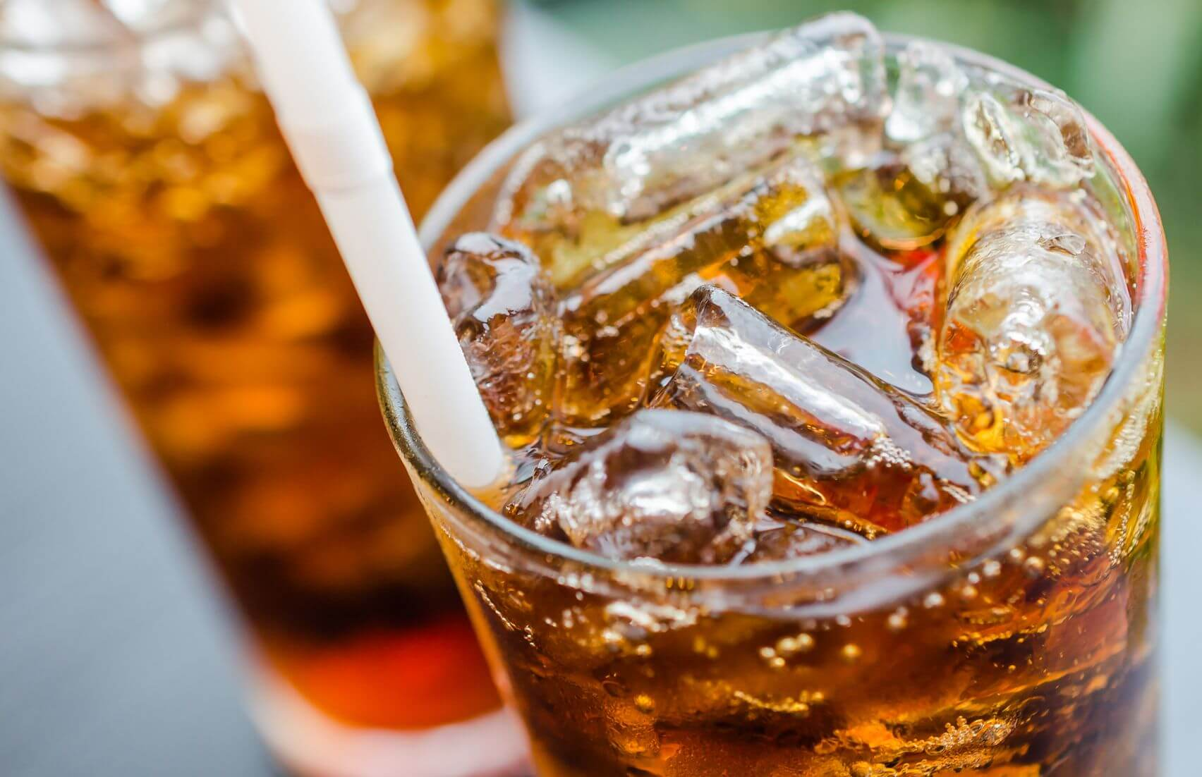Coke with ice in glass - another food high in sugar making you fat